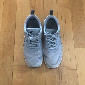 Bluish grey Nike shoes